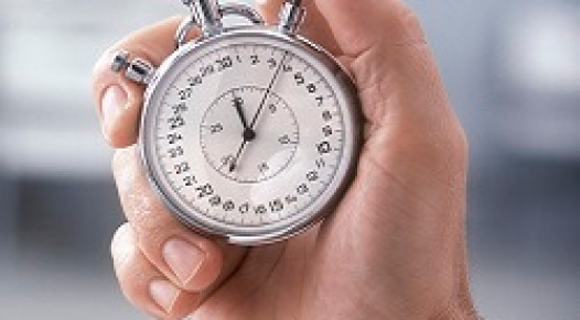 A close-up of someone holding a stopwatch