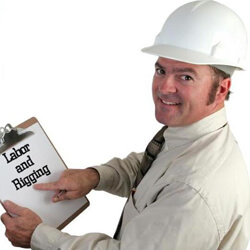 Man with hard hat and clip board that reads Labor and Rigging, trade show solutions, Skyline Entourage