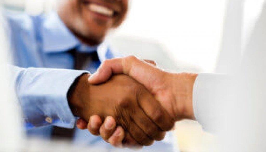 Unrecognizable businessmen shaking hands.