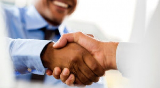 Unrecognizable businessmen shaking hands.