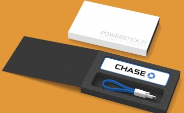 """The PowerStick IV is the newest addition to the PowerStick family of chargers. Keep your phone charged anywhere and anytime with the 2300 mAh back-up battery. The PowerStick IV features a classic """"stick"""" design with new soft touch rubber finish along the outer edge. 4 colors available: black, grey, red and aquamarine. Includes a matching, magnetic micro USB charging cable. Apple users can use their own cable or add an MFI Apple Lightning tip."""