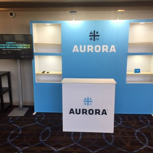 Aurora Cannabis 10x10 blue immerse with box cutouts and white counter, Skyline Entourage