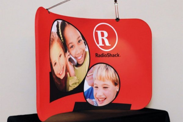 Radioshack curved red table top graphic, trade show solutions, Skyline Entourage