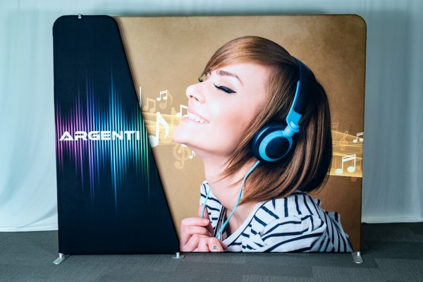 Sample graphic invita of woman with headphones and name branding section, trade show solutions, Skyline Entourage