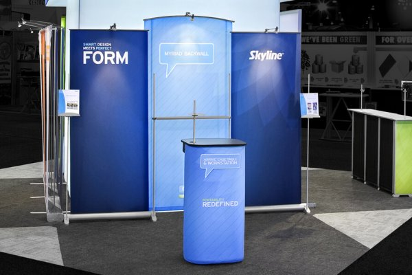 Blue myriad banner stands with podium counter, trade show solutions, Skyline Entourage