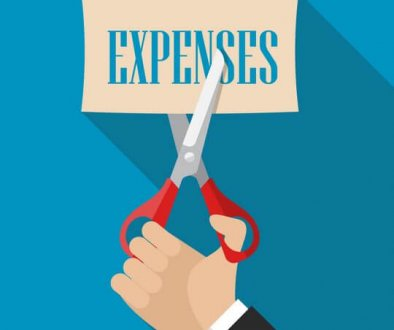 Graphic of a hand with scissors cutting the word expenses, trade show solutions, Skyline Entourage