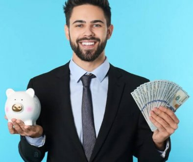 Man in suit holding cash and a piggy bank, trade show solutions, Skyline Entourage