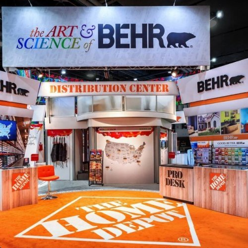 Corner section of Behr booth with return walls, counters and large mounted sign, exhibit solutions, Skyline Entourage