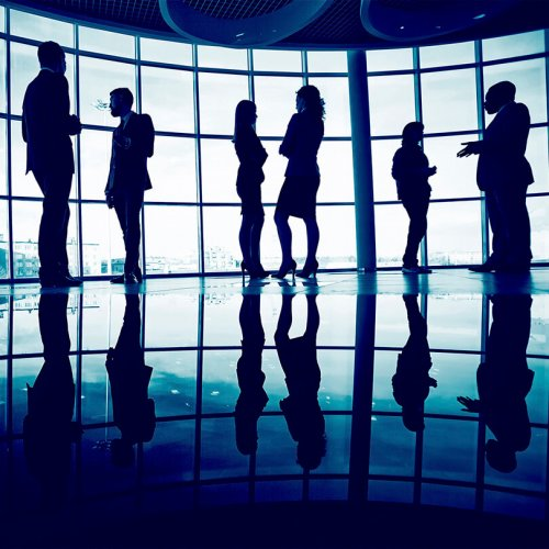 Silhouettes of business people networking in a lobby, trade show marketing, Together Again, Skyline Entourage