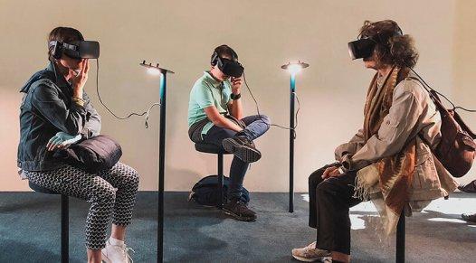 People sitting and wearing virtual reality headsets, trade show marketing, Skyline Entourage