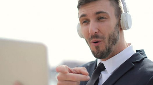 Man with tablet and headphones engaging with video call, trade show marketing, virtual event world, Skyline Entourage