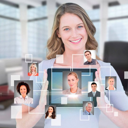 Smiling business woman with tablet and photos of business contacts, trade show marketing, Lead Generation, Skyline Entourage