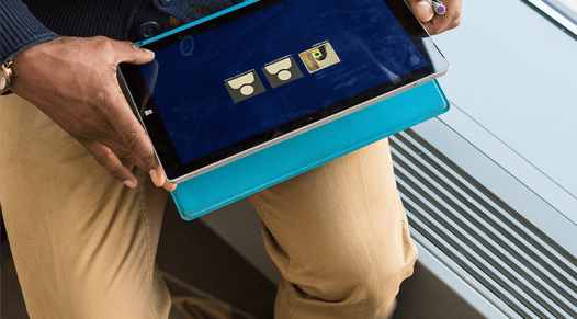 Close up overhead shot of a person holding a tablet device, covid-19 safety solutions, Touch screens, Skyline Entourage