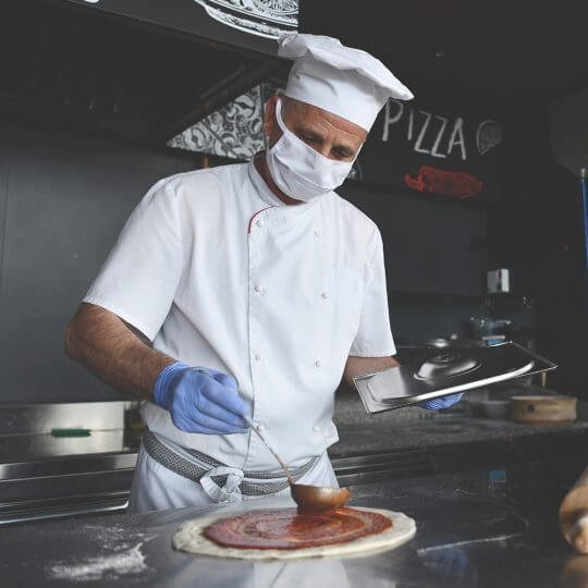 Chef making pizza in the kitchen, food service industry during the pandemic, trade shows, National Restaurant association show, skyline entourage