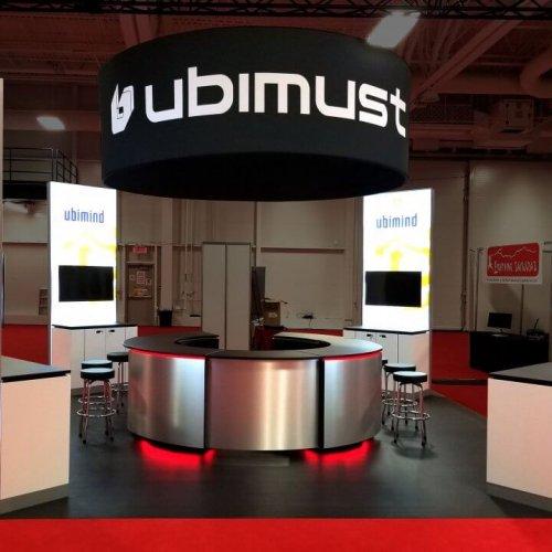 Ubimust, 20x20 custom island trade show exhibits, skyline entourage